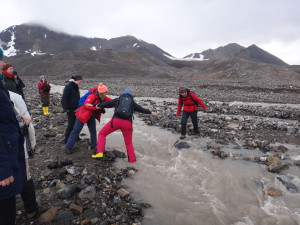 Crossing glacier streams can be challenging.