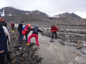Crossing glacier streams can be challenging.