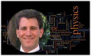 Douglas Natelson in front of a wordle.net Wordcloud of one of his recent blogposts