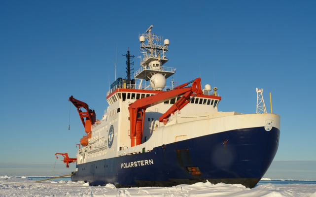 Research icebreaker RV Polarstern amidst snow-covered pack ice