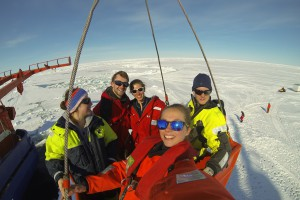 Successful scientists enjoying the sunshine after busy work on the ice while waiting to be transported back onboard by mummy cage, back row L-R: Sarah Zwicker, Mischa Ungermann, Ulrike Dietrich, Achim Randelhoff; front row: Christine Dybwad. Photo: C. Dybwad