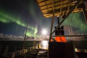 Auroras and the moon shine on Polarstern. Photo: Stefan Hendricks