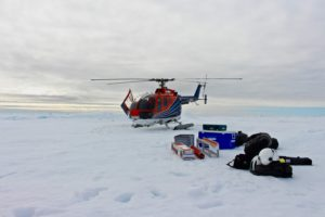 The helicopter on the ice float after dropping us and the equipment. Photo: Josephine Rapp