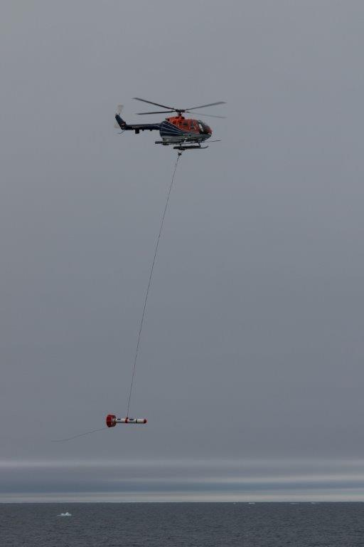 The EM-bird flown below one of two Polarstern Helicopters. Image credit: Marcel Nicolaus.