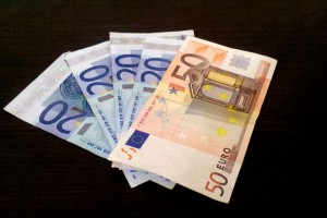 """The image above depicts a euro banknote. This design is copyrighted by the European Central Bank (ECB), and its use is permitted by ECB, subject to the conditions set forth in decisions ECB/2003/4 and ECB/2003/5 of 20 March 2003 and """"as long as reproductions in advertising or illustrations cannot be mistaken for genuine banknotes."""