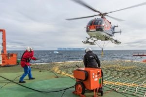 Polarstern's BO-105 helicopter departing with the magnetometer sensor bird. Photo: Thomas Ronge